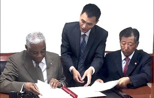 Description: Dr Bernard Nottage accepts the donation of $1.2m from China to pay for military equipment.