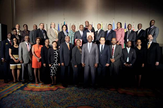 Description: C:UsersAdministratorDownloadsMin Shane Gibson@27th Meeting of CARICOM Heads of Social Security April 27, <a href=