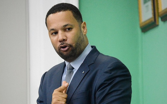 Description: Andre Rollins speaks in the House of Assembly.
