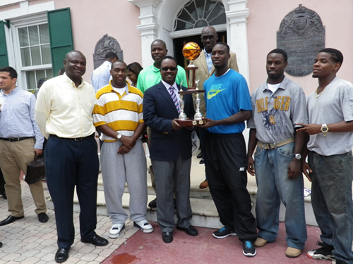 The photo shows MP Dr. Johnson presented the trophy to the winning team at the steps of the House of Assembly on Wednesday 3rd September.