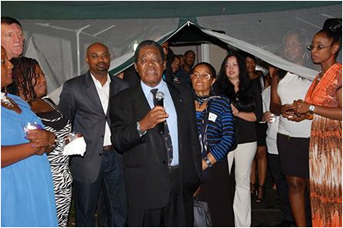 "His Excellency Dr. Eugene Newry, Bahamas Ambassador to the United States, is pictured welcoming guests to the ""Night In The Bahamas"" on Saturday, September 6, 2014. At left of Dr. Newry is Mr. Chet Neymour, Deputy Chief of Mission; at right of the Ambassador his wife Mrs. Francoise Torchon Newry; and far right is Miss Krissy Hanna, Second Secretary, Embassy of The Bahamas."