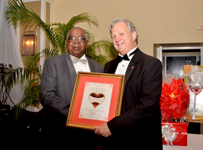 Bismark Coakley (left) receiving an award at the annual Heart Ball.
