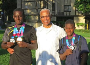 Honorary Consul of The Bahamas to California Cedric A. Scott is flanked by swimmers Bahamian swimmers and medal winners Cornel McClain (left), Silver Medal winner, and Lavontae Clarke, Silver Medal winner