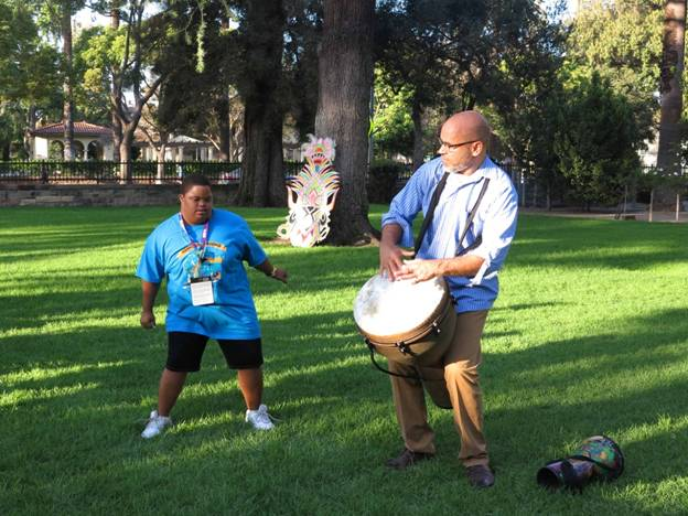 Team Bahamas supporter Vashni Thompson dances to the drumming of Dr. Adrian Lunn at the reception hosted by Honorary Consul of The Bahamas to California Cedric A. Scott the Annenberg House on the campus of the University of Southern California on Monday, July 17.